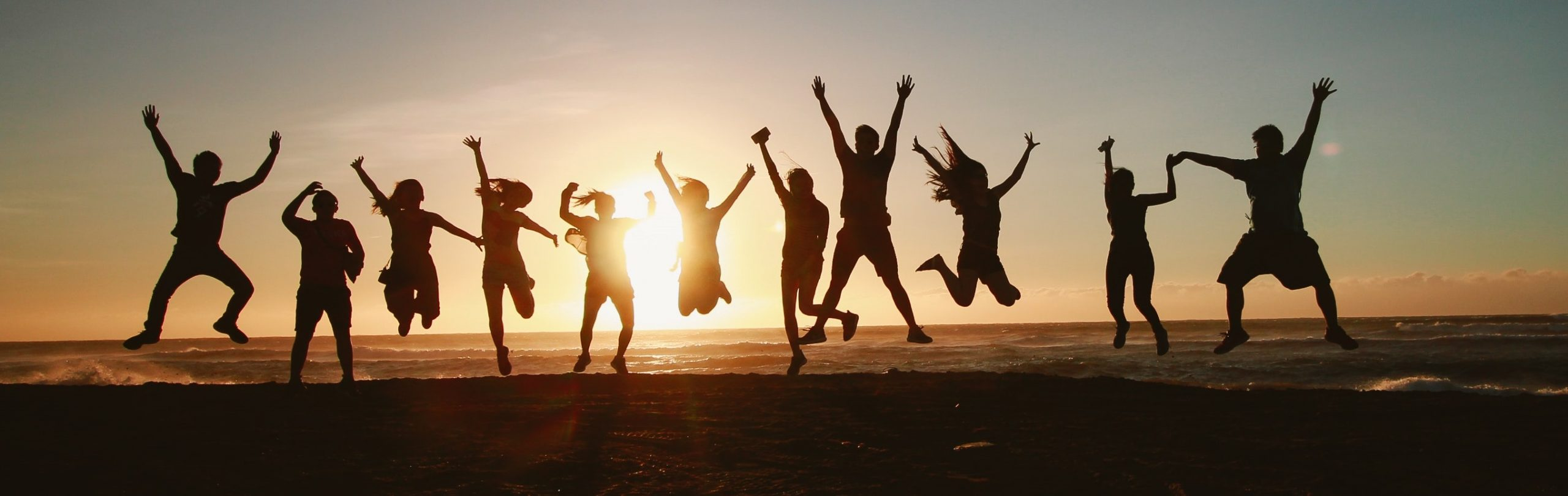 silhouette-photography-of-group-of-people-jumping-during-1000445 a